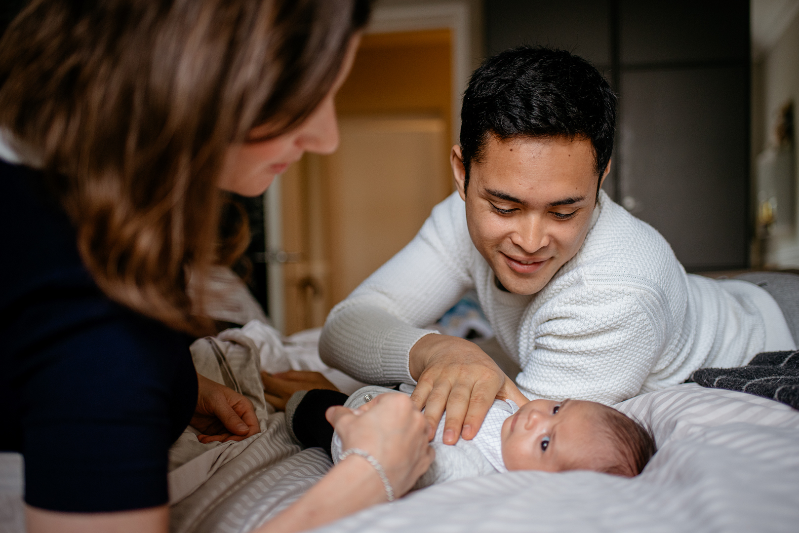 New mum and dad cuddle time with their newborn baby,newborn baby photography in Bristol by Agi Lebiedz